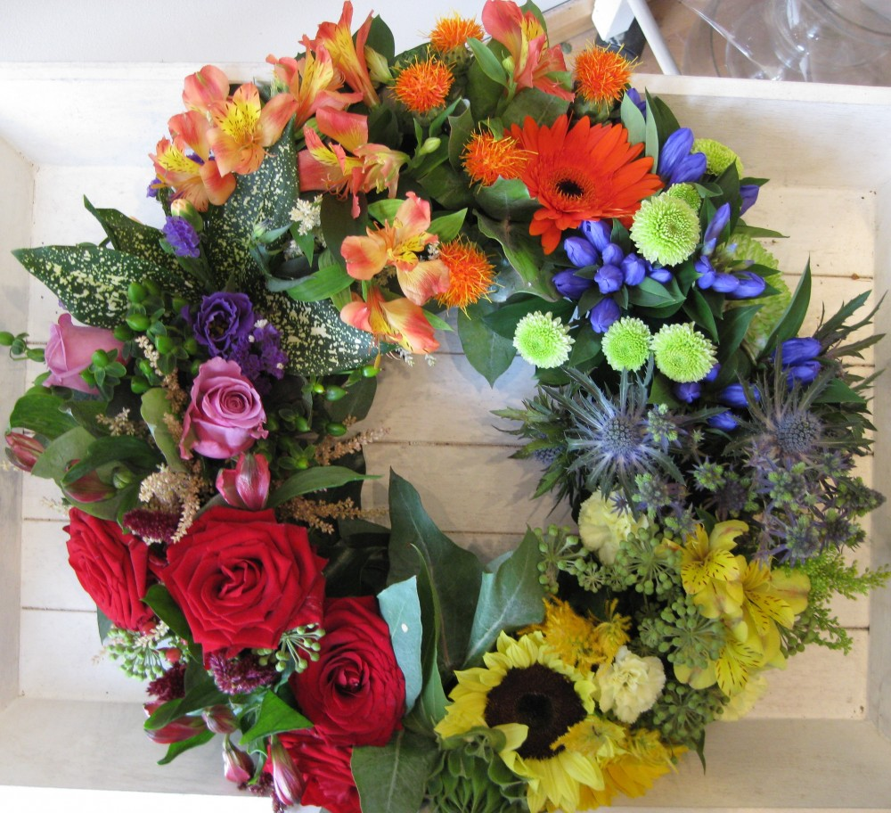 Funeral tributes flowers sonning common funeral tributes flowers rainbow grouped wreath izmirmasajfo